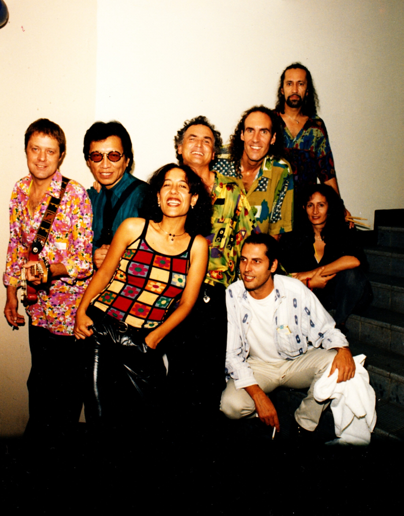Left-to-right: Willem Moller, Sixto Rodriguez, Tonia Selley, Steve Louw, Graeme Currie, Reuben Samuels Kneeling front: Russel Taylor
