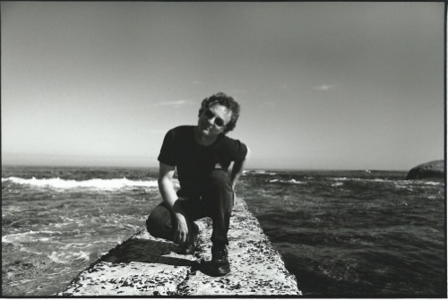 Steve at the beach in Camps Bay, 1997. The sea is a powerful creative influence on Steve, who swims in the ocean every day.
